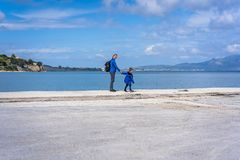 Mother and son on the shore royalty free stock images