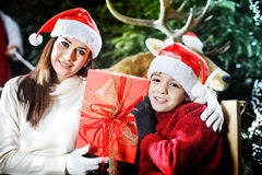 Mother and son show the gift that brought Santa Claus Stock Photos