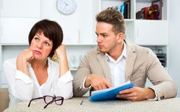 Mother and son sign documents Royalty Free Stock Image