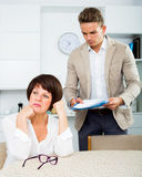 Mother and son sign documents Royalty Free Stock Photography