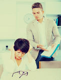 Mother and son sign documents Royalty Free Stock Photos