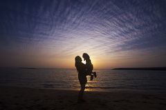 Mother and Son silhouette. Mother and Son having fun together at beach with beautiful sunset background Stock Photography