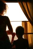 Mother with son silhouette in train Royalty Free Stock Photos