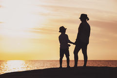 Mother and son silhouettes at the sunset time Royalty Free Stock Images