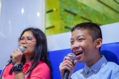 Happy boys singing stock photo