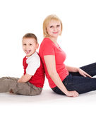 Mother and the son sit on a floor. Stock Photos
