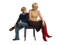 Mother and the son sit on one chair. Mother and the son sit on one chair, over white background Royalty Free Stock Image