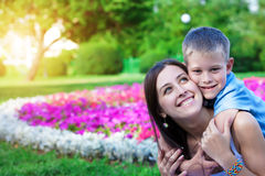 Mother and son siting on grass Royalty Free Stock Images