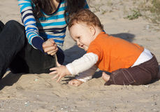 A mother and son sitting on the beach Royalty Free Stock Photography