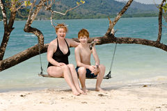 Mother and son sitting on a beautiful swing Royalty Free Stock Image