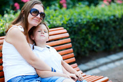 Mother and son sitting on bench Stock Photography