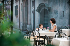 Mother and son sitting in cafe Royalty Free Stock Photos