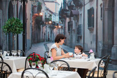 Mother and son sitting in cafe Royalty Free Stock Images