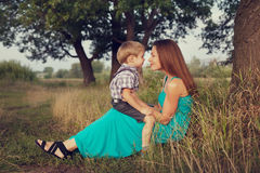 Mother and son sitting face to face in countryside Royalty Free Stock Photo