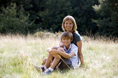 A mother and son sitting on the grass Royalty Free Stock Images