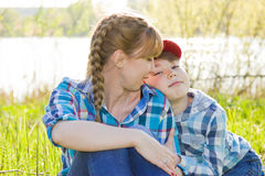 Mother and son sitting on the grass Stock Photos
