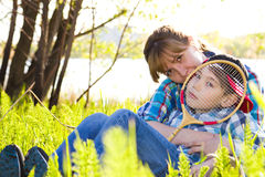 Mother and son sitting on the grass Stock Images