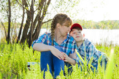 Mother and son sitting on the grass Royalty Free Stock Images