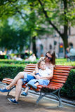 Mother and son sitting outdoors Royalty Free Stock Image