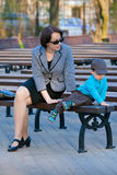 Mother and son sitting outdoors Royalty Free Stock Photos