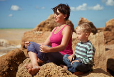 Mother and son in sitting relaxation pose Royalty Free Stock Image