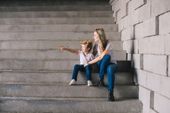 Mother with son sitting on a stairs Royalty Free Stock Photos
