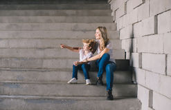 Mother with son sitting on a stairs Stock Photo