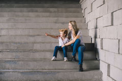 Mother with son sitting on a stairs Royalty Free Stock Photo