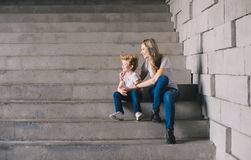 Mother with son sitting on a stairs Stock Photography