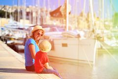 Mother and son sitting in summer port Stock Photo
