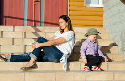 Mother and son sitting in the sun Stock Photos