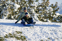 Mother and Son Sledding down the Hill Royalty Free Stock Photos