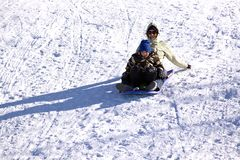 Mother and Son Sledding down the Hill Stock Photos
