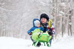 Mother and son on sledge Stock Photography