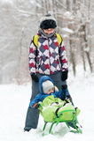 Mother and son on sledge Stock Image