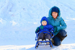 Mother and son on sledge in winter Royalty Free Stock Photography
