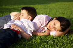 Mother and son sleeping outdoor Stock Photos