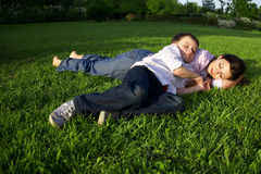 Mother and son sleeping outdoor Royalty Free Stock Images