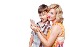 Mother and son with smartphone, wireless technology Royalty Free Stock Images