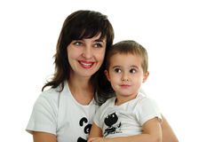 Mother and son smile. Mother and son in white T-shirts on white background stock photo