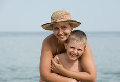 Mother with the son smile against the sea Royalty Free Stock Photography