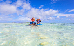 Mother and son snorkeling on beach Stock Photos