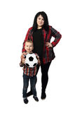 Mother and son with soccer ball. Black haired women stands together with small boy holding a soccer ball in hands - Mother and little son isolated on white Royalty Free Stock Photography