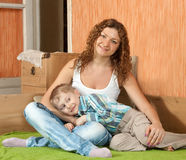 Mother with son on sofa stock photo