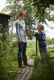 Mother And Son With Spade In Garden Royalty Free Stock Photo