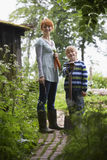 Mother And Son With Spade In Garden Royalty Free Stock Image