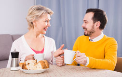 Mother and son spending time. Mature mother and adult son happy to spend time together at home Stock Photo