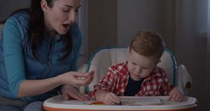 Mother and Son Spending Time Together Drawing with Colored Pencils Crayons stock video