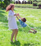 Mother and son spinning Royalty Free Stock Images