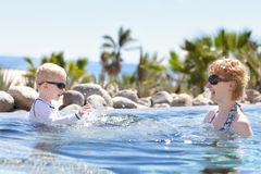 Mother and son splashing Royalty Free Stock Photo